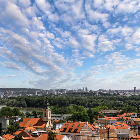 Panoramic view from Gardos lookout on town of Zemun, Church of Ascension of the Holy Virgin Mary Bell Tower, War island on river Danube and Belgrade skyline - Zemun, Belgrade, Republic of Serbia  photo