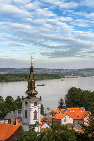 Photograph of panoramic view from Gardos - Zemun, with Saint Nicholas church baroque bell tower and river Danube  Zemun, Belgrade, Republic of Serbia  photo
