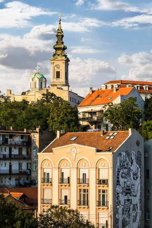 Old part of Belgrade downtown, Republic of Serbia, with Patriarchy of the Serbian Orthodox Church, St  Michael s Cathedral bell tower, and Building with decorative mural in Karadjordjeva Street   photo