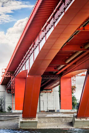 refurbished: Photograph of refurbished graceful Gazelle Bridge, with it s huge  gazelle jump  red-painted girder span, connecting Sava river banks, Old Belgrade downtown and New Belgrade, Republic of Serbia