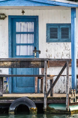 floaters: Photograph represents an old, handmade wooden white-blue painted hut, placed among many, side by side, along the Sava river banks, Belgrade - Republic of Serbia  Stock Photo
