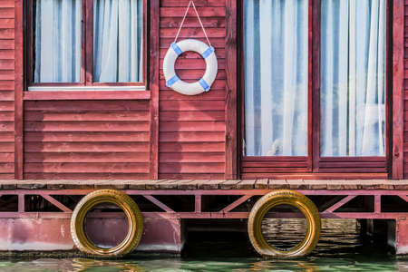 Photograph represents detail of an old, handmade weekend leisure wooden raft hut, placed among many, side by side, along the Sava river banks, Belgrade - Republic of Serbia  photo