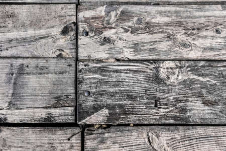 weathered rotten floorboards with rough surface. photo