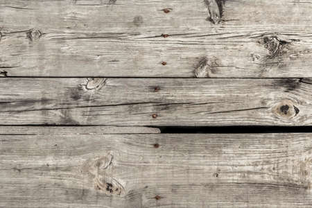 old weathered discolored rotten floorboards photo