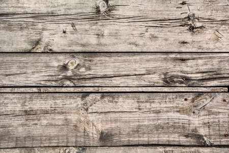 discolored: old weathered discolored rotten floorboards