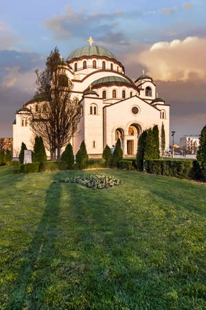 copper coated: the Temple of Saint Sava exterior at dusk Stock Photo