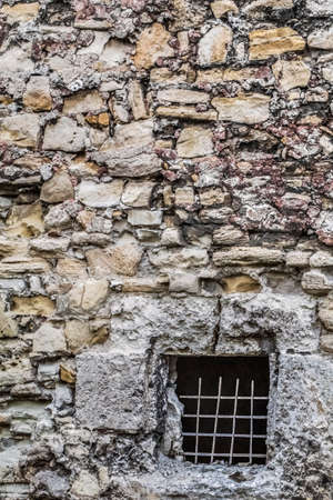 rampart: Photograph of medieval fortress stone rampart with dungeon window detail  Stock Photo