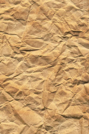 Photograph of recycle brown kraft paper, crushed, crumpled grunge texture sample photo