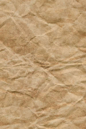Photograph of recycle brown kraft paper, crushed, crumpled grunge texture sample