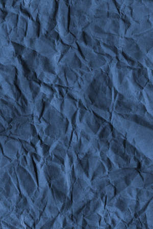 Photograph of recycle dark Marine blue paper coarse grain, crumpled grunge texture sample photo