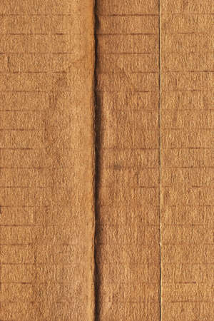 patched: Photograph of recycle brown corrugated, coarse grain, striped, grooved, patched, cardboard, grunge texture sample