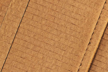 grooved: Photograph of recycle brown corrugated, coarse grain, striped, grooved, patched, cardboard, grunge texture sample