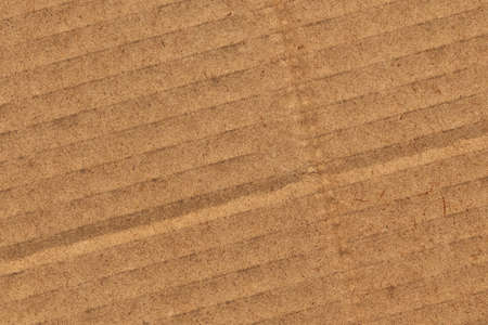 Photograph of recycle brown corrugated, coarse grain, striped, grooved, cardboard, grunge texture sample photo