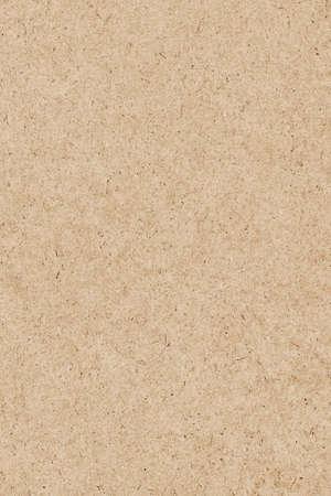 Photograph of recycle Pale Ochre kraft paper, coarse grain, grunge texture sample Фото со стока