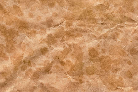 Photograph of recycle brown kraft paper, coarse grain, crumpled, grunge texture photo