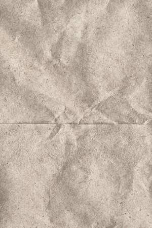 detai: Photograph of recycle off white paper grocery bag, coarse grain, crumpled grunge texture - detai