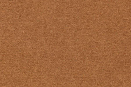 umber: Photograph of Burnt Umber Brown Recycle Paper, coarse grain, grunge texture sample