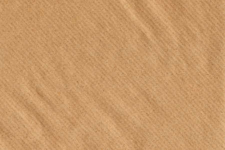 Photograph of old Recycle, Striped Kraft Brown Paper, coarse grain, crumpled, grunge texture sample  Reklamní fotografie