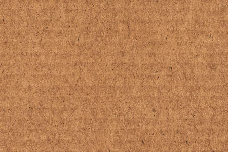 Photograph of recycle brown striped, corrugated, coarse grain, cardboard grunge texture sample  Stock Photo