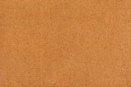 Photograph of recycle brown striped, corrugated, coarse grain, cardboard torn grunge texture sample photo