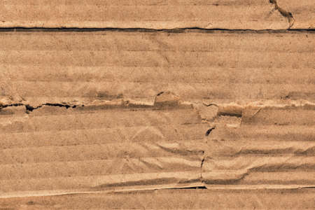 Photograph of recycle Brown corrugated striped cardboard, coarse grain, obsolete, torn, grunge texture sample  photo