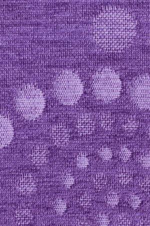 acrylic fiber: Photograph of Violet woven Acrylic-Polyethylene Upholstery fabric, with decorative circular pattern ? detail. Stock Photo
