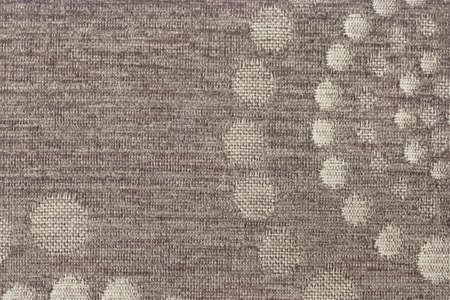 acrylic fiber: Photograph of dark Gray woven Acrylic-Polyethylene Upholstery fabric, with decorative circular pattern ? detail. Stock Photo