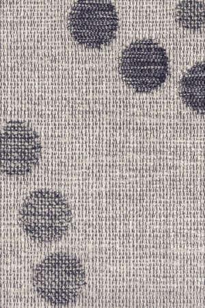 acrylic fiber: Photograph of light Gray woven Acrylic-Polyethylene Upholstery fabric, with decorative circular pattern ? detail.