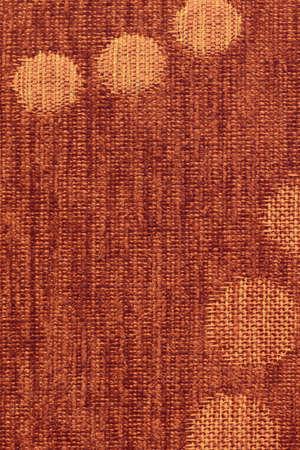 acrylic fiber: Photograph of Red - Orange woven Acrylic-Polyethylene Upholstery fabric, with decorative circular pattern ? detail.