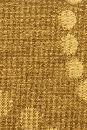 acrylic fiber: Photograph of Yellow woven Acrylic-Polyethylene Upholstery fabric, with decorative circular pattern ? detail.