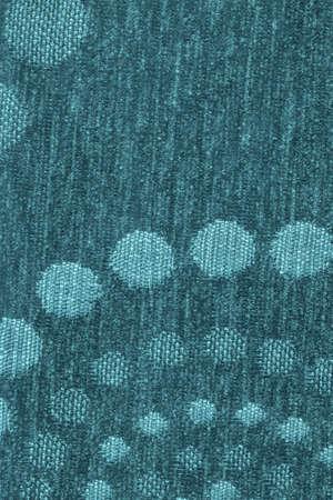 acrylic fiber: Photograph of dark Emerald Blue woven Acrylic-Polyethylene upholstery and drapery fabric, with decorative circular pattern ? detail. Stock Photo