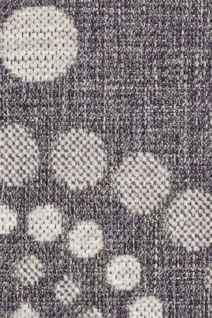 acrylic fiber: Photograph of dark Gray woven Acrylic-Polyethylene upholstery and drapery fabric, with decorative circular pattern ? detail.