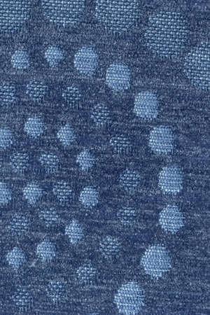 acrylic fiber: Photograph of dark Marine Blue woven Acrylic-Polyethylene upholstery and drapery fabric, with decorative circular pattern ? detail.
