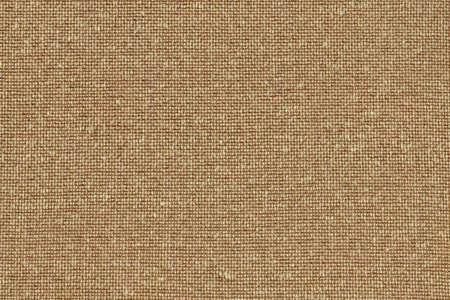 Photograph of Yellow Ocher Acrylic-Polyethylene upholstery and drapery fabric, with woven decorative mesh pattern ? detail. photo