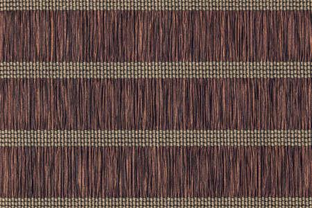 umber: Dark Umber brown straw mat grunge texture.