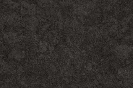 Photograph of Charcoal Black Recycle Kraft Paper, coarse grain, bleached, mottled, spotted, grunge texture sample. Reklamní fotografie