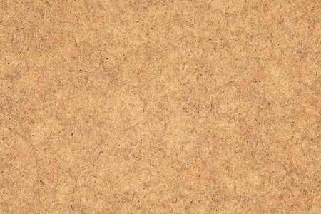 Photograph of Recycle Kraft Brown Paper, coarse grain, blotted, mottled, spotted, grunge texture.
