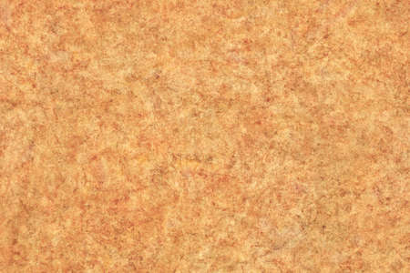 vellum: Photograph of old, Yellow-ocher animal skin parchment, coarse grained, grunge texture. Stock Photo