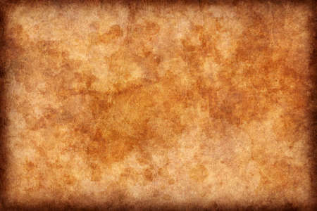 background images: Photograph of old, dark Ocher-brown animal skin parchment, coarse grained, vignette grunge texture. Stock Photo