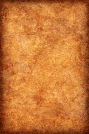 Photograph of old, dark Ocher-brown animal skin parchment, coarse grained, vignette grunge texture. Stock Photo