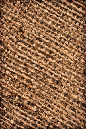 gunny: Photograph of roughly woven, extra coarse grain, burlap vignette grunge texture.