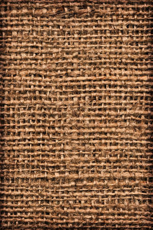 threaded: Photograph of roughly woven, extra coarse grain, burlap vignette grunge texture.