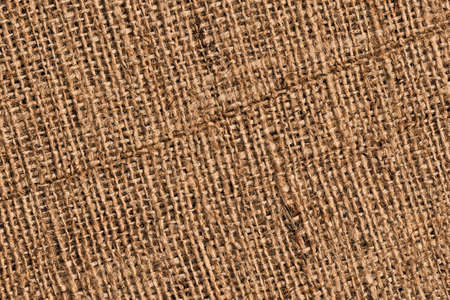 threaded: Photograph of roughly woven, extra coarse grain, burlap grunge texture.