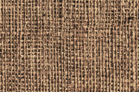roughly: Photograph of roughly woven, extra coarse grain, burlap grunge texture.