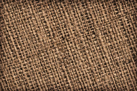 treated: Photograph of roughly woven, extra coarse grain, burlap vignette grunge texture.