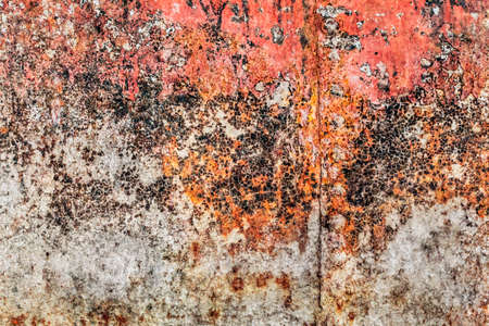 entropy: Old, obsolete, badly corroded river raft hut floater metal surface, covered with cracked decomposed layers of red paint, tar and rust. Stock Photo