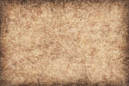 blotted: Photograph of Recycle Beige Paper, coarse grain, bleached, mottled, vignette, grunge texture sample.