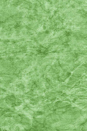 kelly: Photograph of Recycle Kelly Green Striped Pastel Paper, coarse grain, bleached, mottled grunge texture sample. Stock Photo