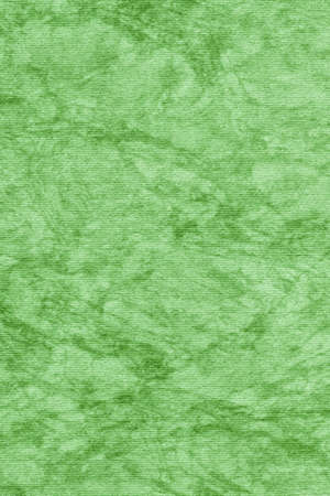 blotted: Photograph of Recycle Kelly Green Striped Pastel Paper, coarse grain, bleached, mottled grunge texture sample. Stock Photo