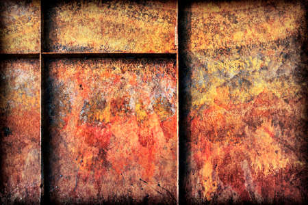decomposed: Old, scrapped, badly corroded Metal river boat bottom surface, reinforced with metal ribs, covered with cracked decomposed layers of paint and rust, vignette texture. Stock Photo